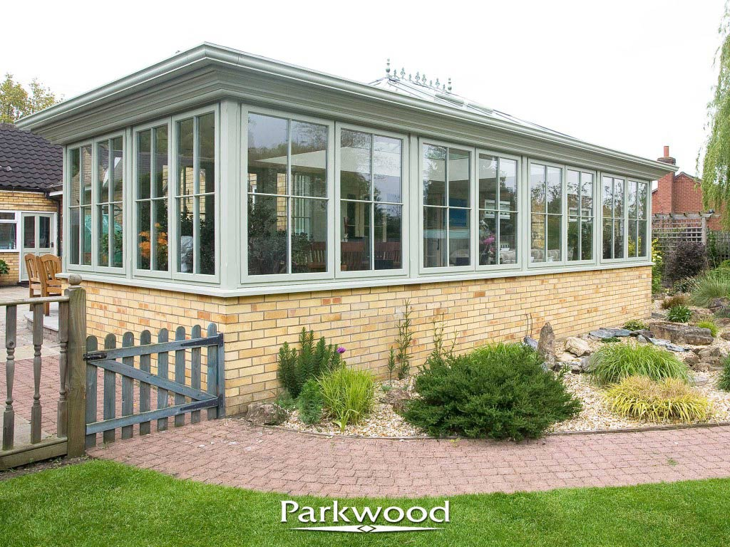 Green painted orangery by Parkwood