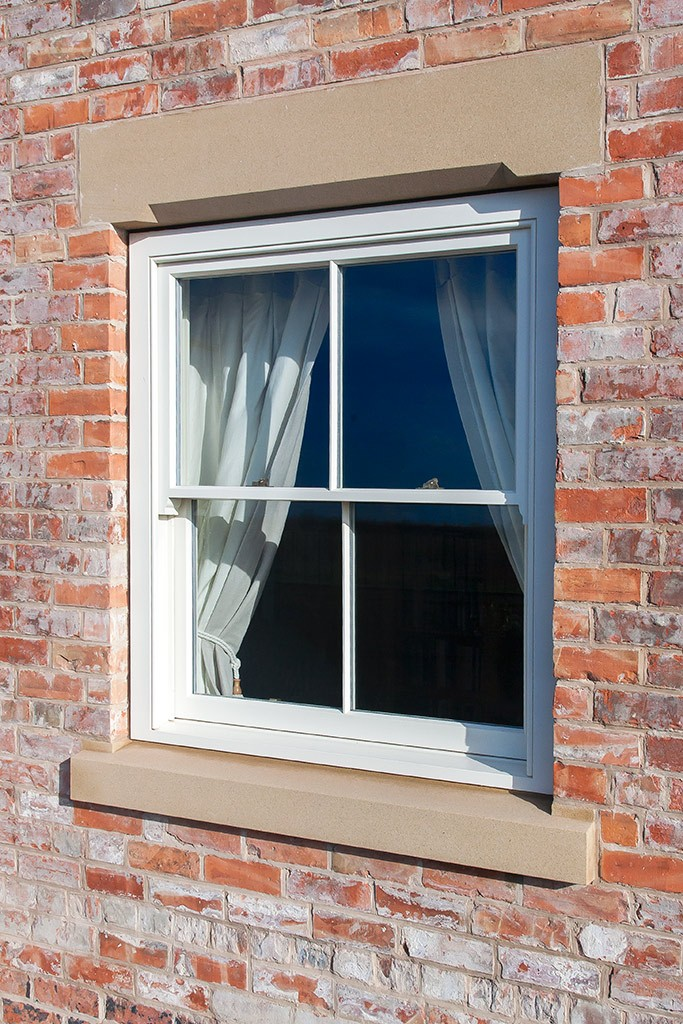Sliding sash window in an almost square opening
