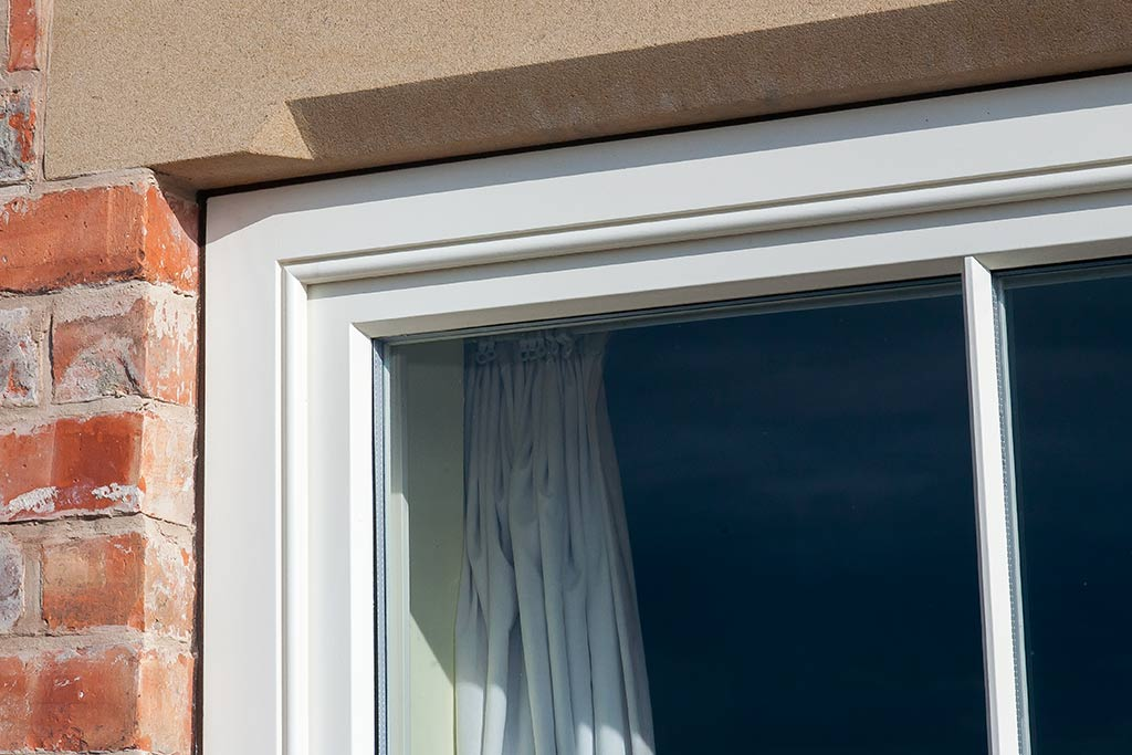 Staff bead and the puttyline window mouldings are complimented by a Stopped chamfered sand stone lintol