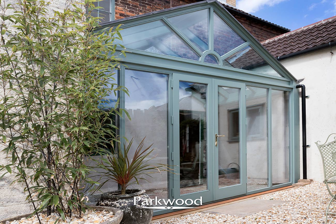 Green Painted Timber conservatory by Parkwood